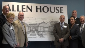 Photo by Devin O'Shaughnessy Members of FM's Board of Trustees, Board of Directors and administration pose in front of the proposed structure, the Allen House.